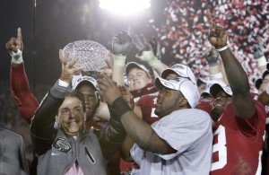 Head coach Saban of Alabama Crimson Tide and Heisman trophy winner Ingram hold championship trophy after their team defeated Texas Longhorns in their NCAA's BCS National Championship football game in Pasadena