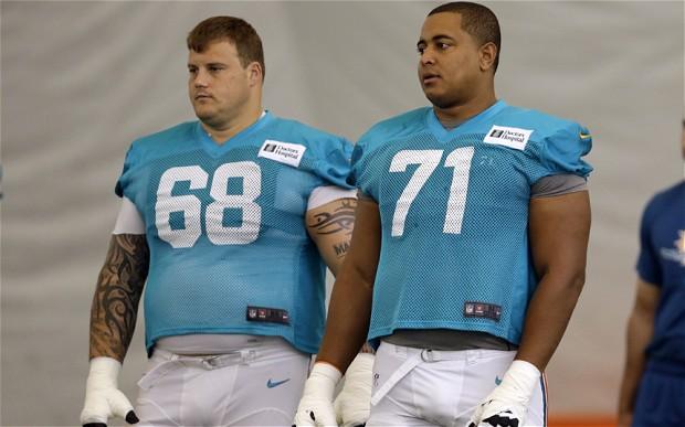 Richie Incognito (izquierda) y Jonathan Martin (AP)