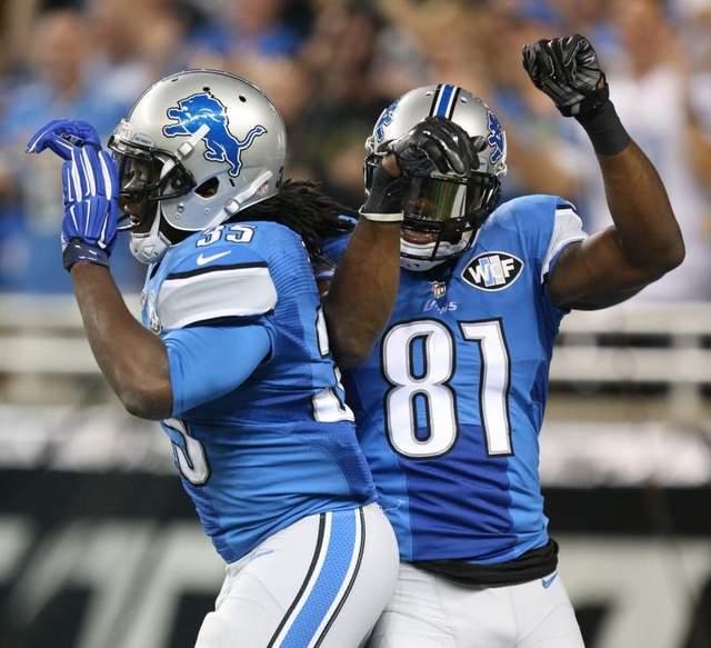 Calnvin Johnson celebra uno de sus touchdowns (AP)