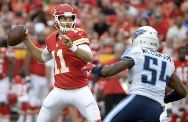 Aug 28, 2015; Kansas City, MO, USA; Kansas City Chiefs quarterback Alex Smith (11) passes against Tennessee Titans inside linebacker Avery Williamson (54) in the first half at Arrowhead Stadium. Mandatory Credit: John Rieger-USA TODAY Sports